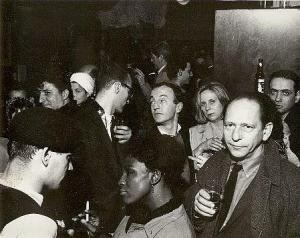 Closing of the Cedar Bar, March 30, 1963 (Fred W. McDarrah) Among those visible are American poets Jack Micheline (1929 - 1998) (born Harold Silver) (left, smiling towards camera), Frank O'Hara (1926 - 1966) (center, looking towards Micheline), and Barbara Guest (1920 - 2006) (looking at camera, in light colored jacket, and American sculptor Abram Schlemowitz (right fore, with glass in hand).